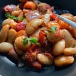 A bowl of Roasted Beans in Tomato Sauce.