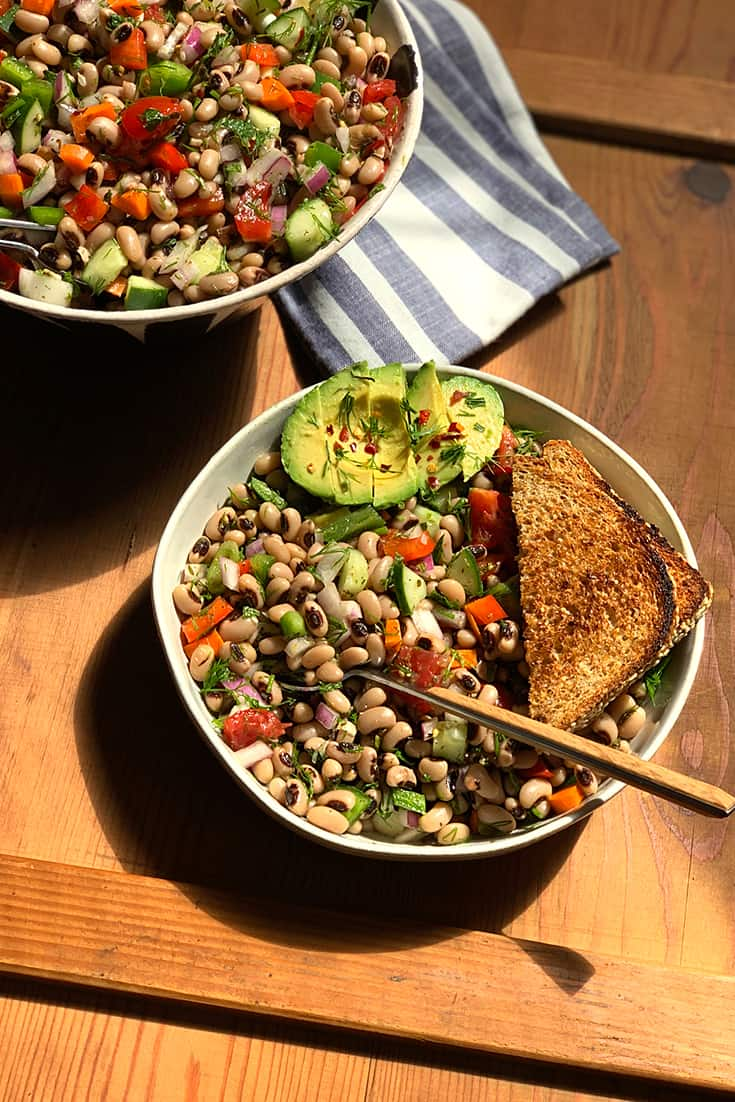 A black-eyed peas salad that is fresh and fragrant and has a mediterranean vibe. With lots of veggies, herbs and an olive oil & vinegar dressing it tastes like summer in a bowl.