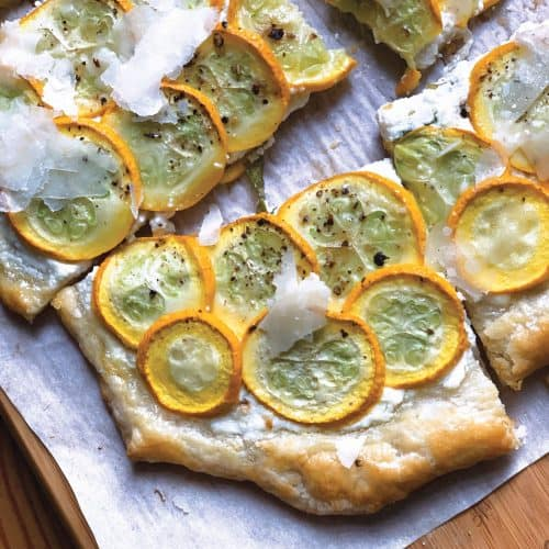 A lovely yellow squash tart with ready-made puff pastry, fresh yellow squash, ricotta, extra virgin olive oil and a sprinkle of lemon zest.