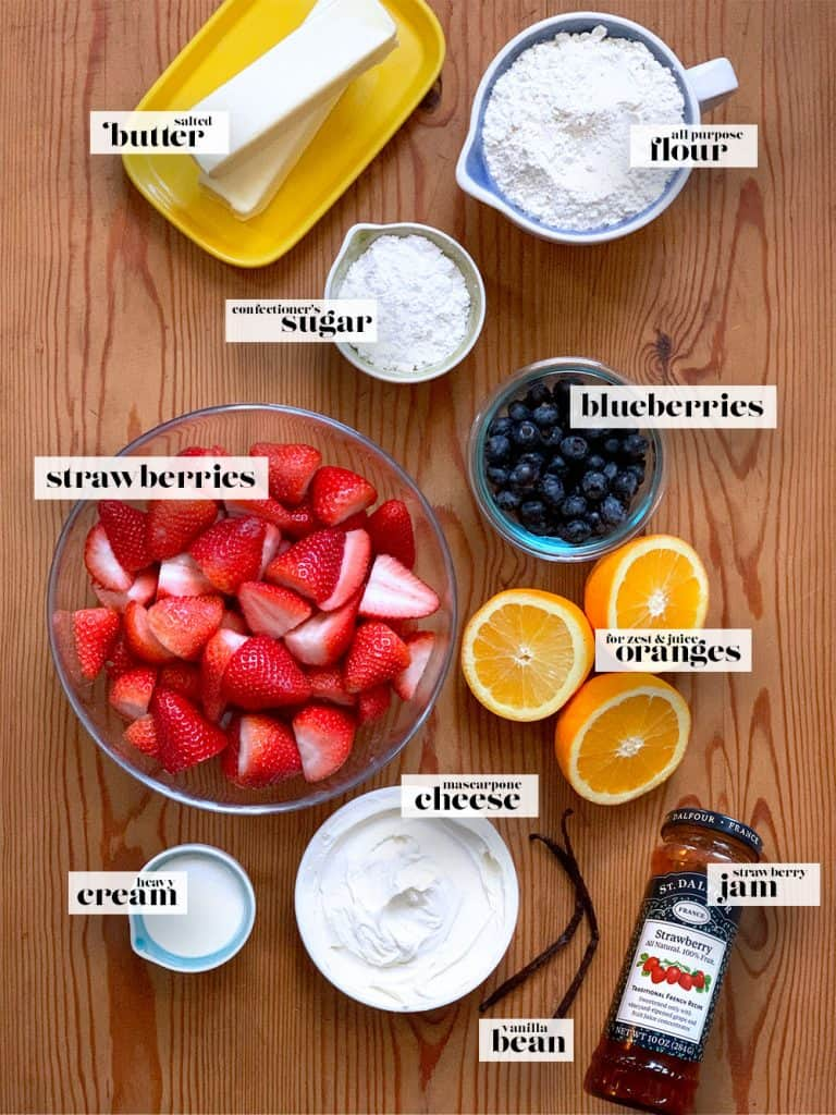 A board showing ingredients for the berry tart.