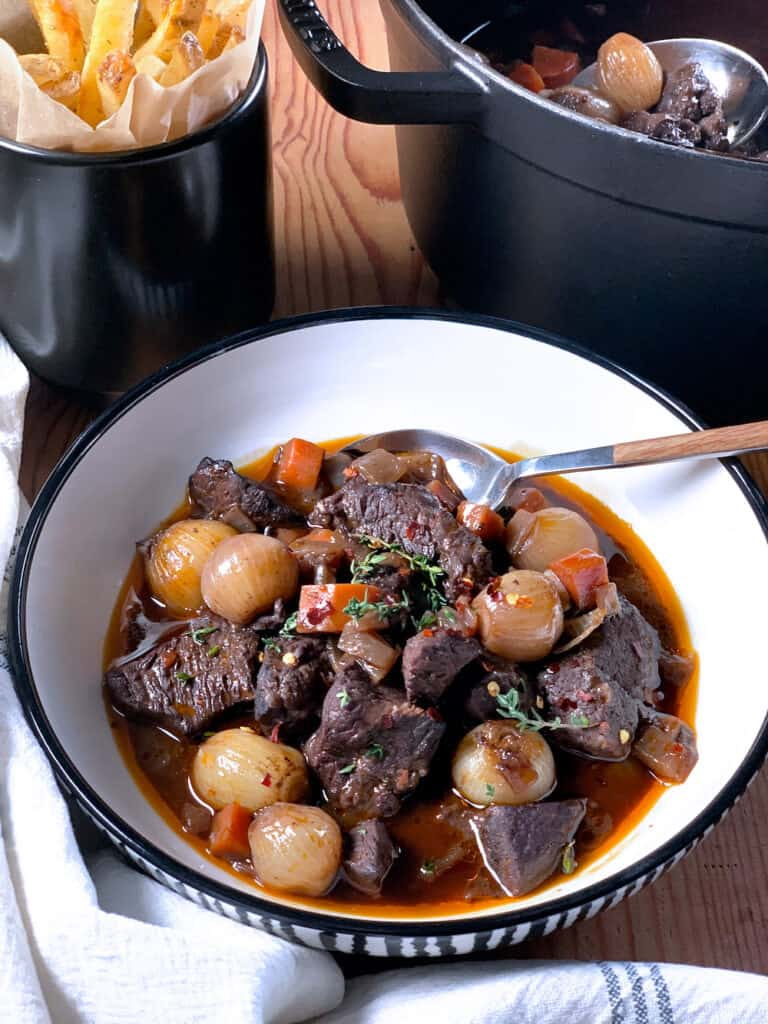 A bowl with red wine beef stew