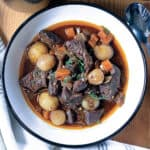 A bowl with wine beef stew.
