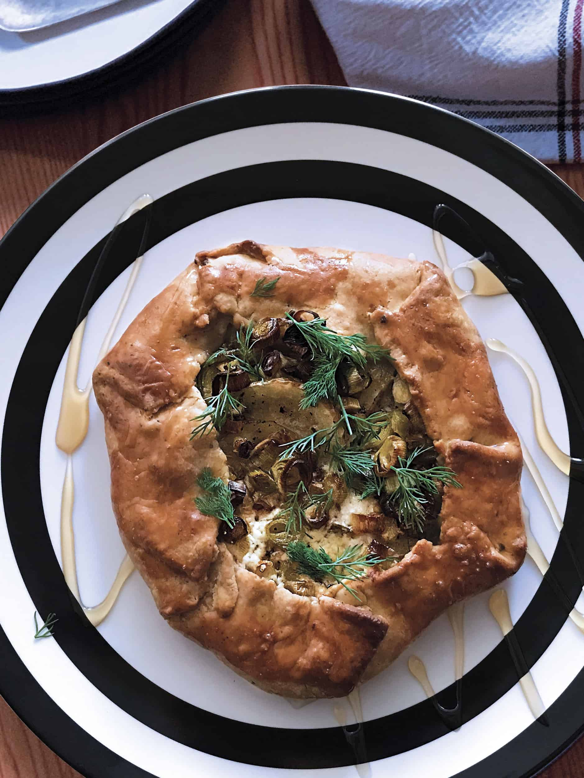A leek and potato galette on a plate.
