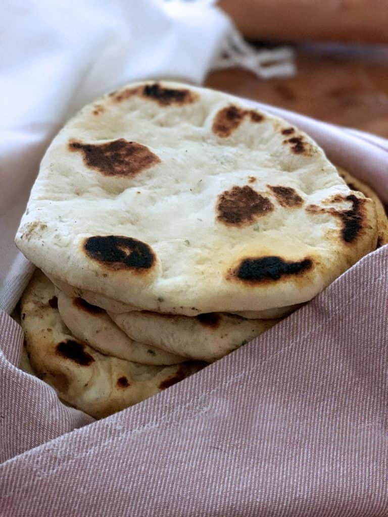 Greek flatbreads-pita wrapped in a tea towel.
