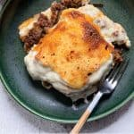 Pinterest Pin. A plate with vegetarian moussaka.