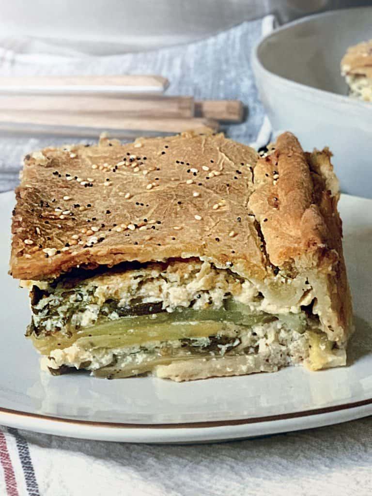 A piece of boureki pie on a plate.