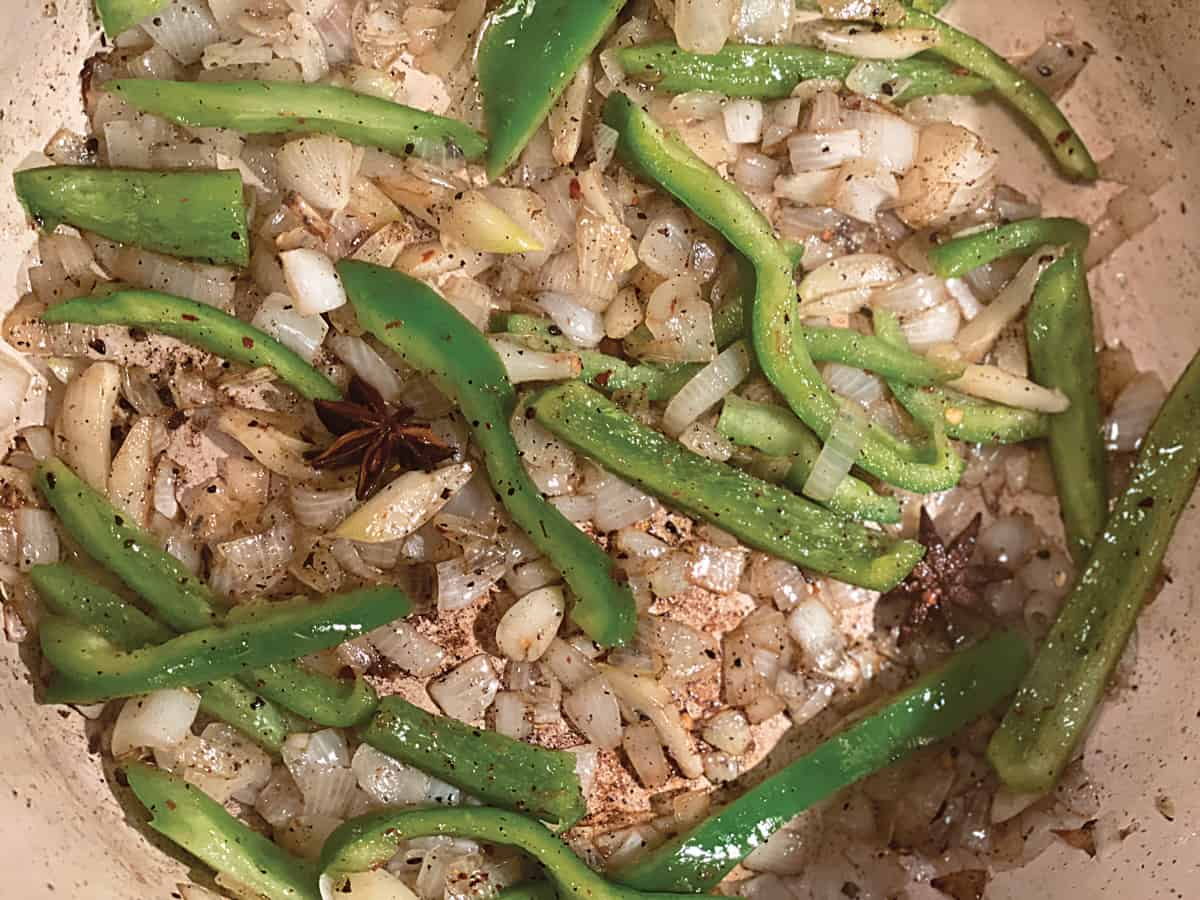 Diced onions, green peppers sautéing  in olive oil.