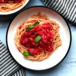 A plate with spaghetti and greek tomato basil sauce