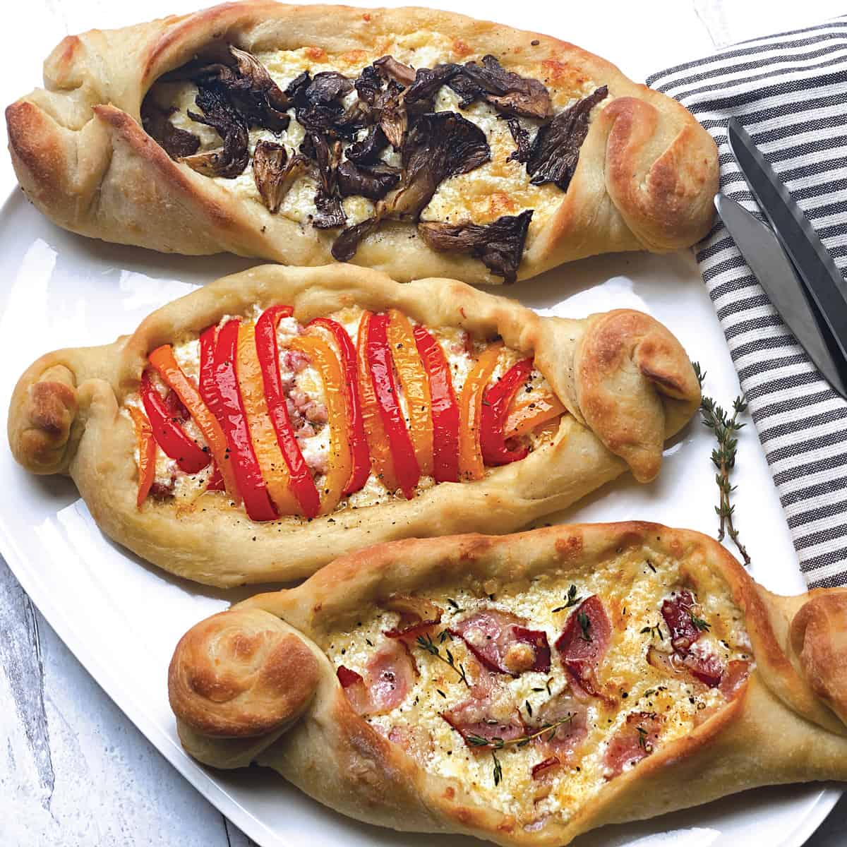 Peinirli-Greek pizza boats in 3 different flavors