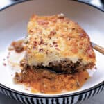 A plate with a piece of sweet potato moussaka.