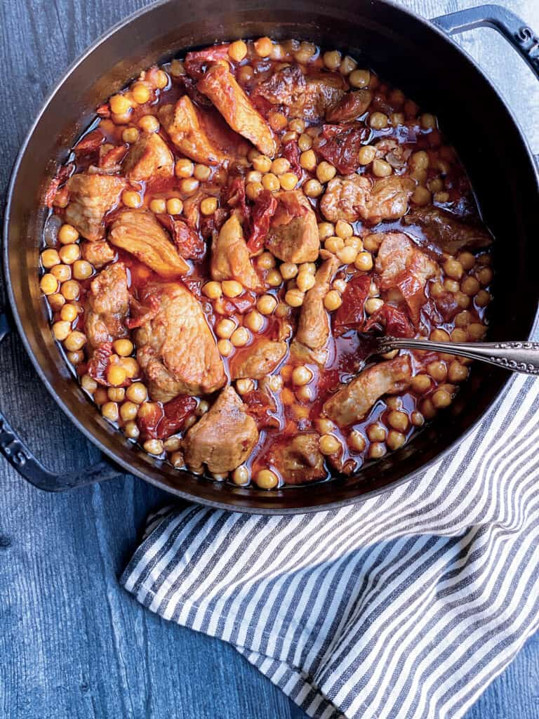 A dutch oven with chickpea and pork stew.