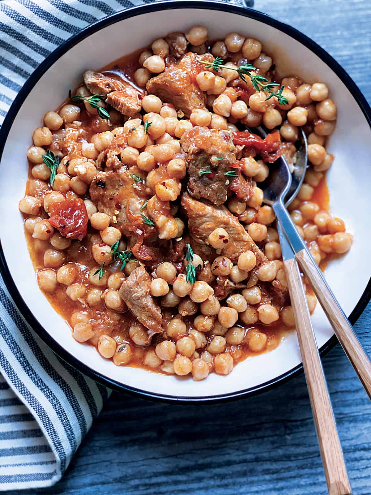 A plate with chickpea and pork stew.