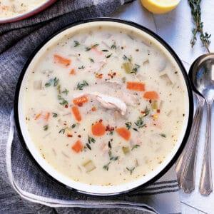 A bowl with greek lemon chicken soup.