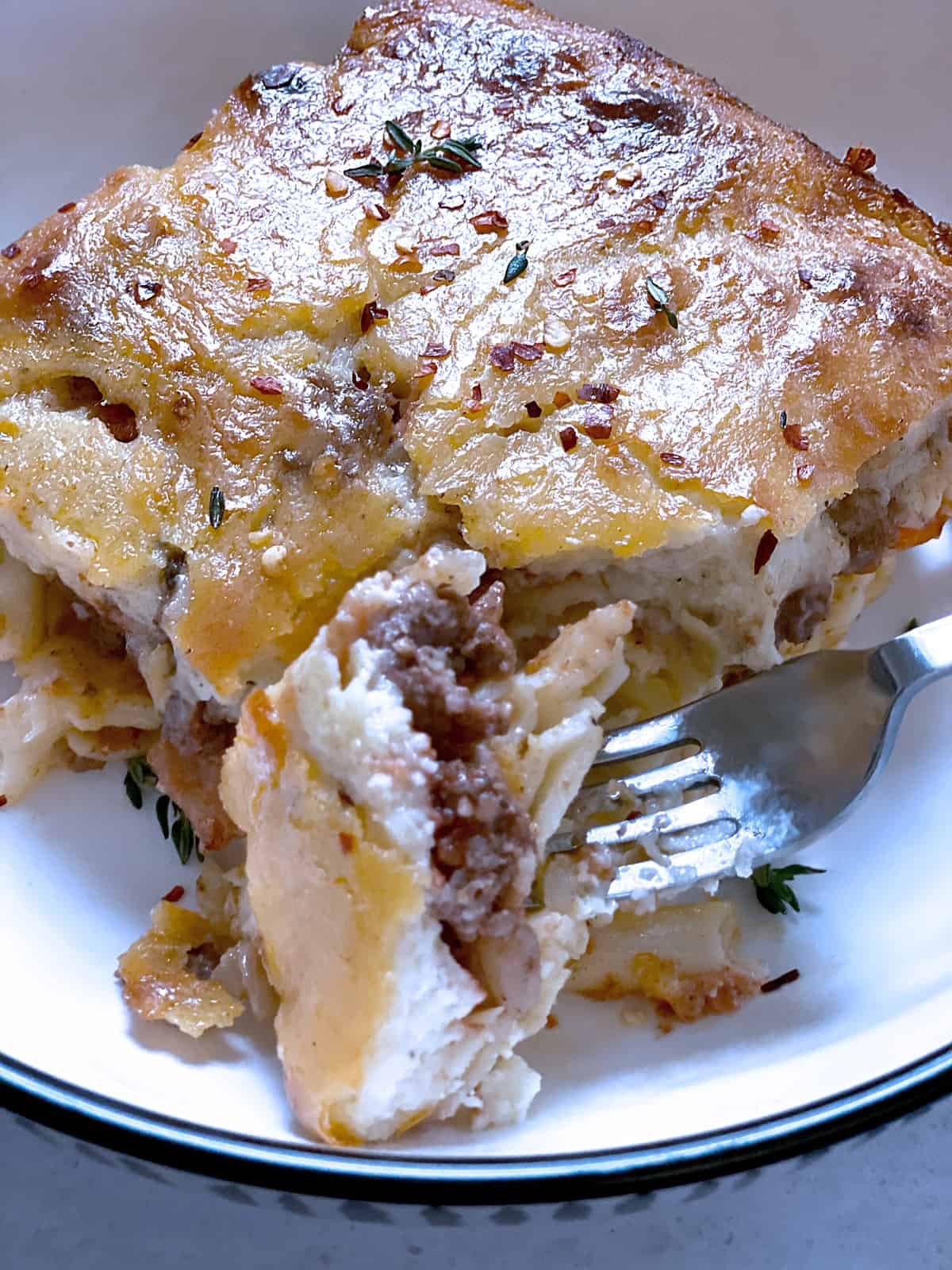 Apiece of Pastitsio and a fork.