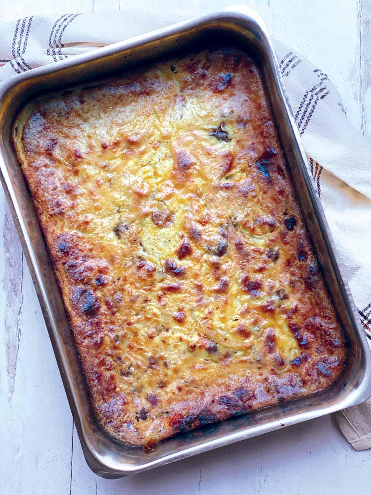 Baked Pastitsio-greek lasagna in a baking pan.