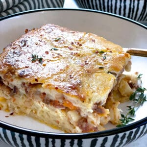 A plate with a piece of Pastitsio-Greek lasagna.