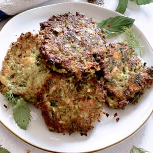 A plate with zucchini fritters.