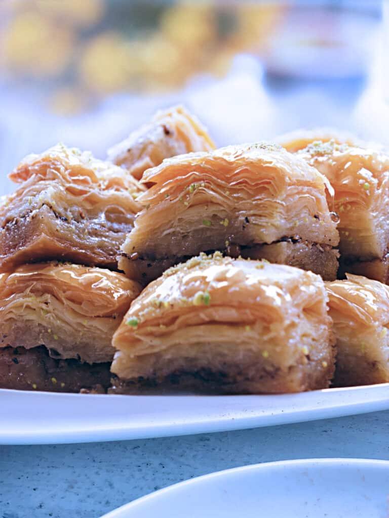 A serving plate with pistachio baklava pieces.