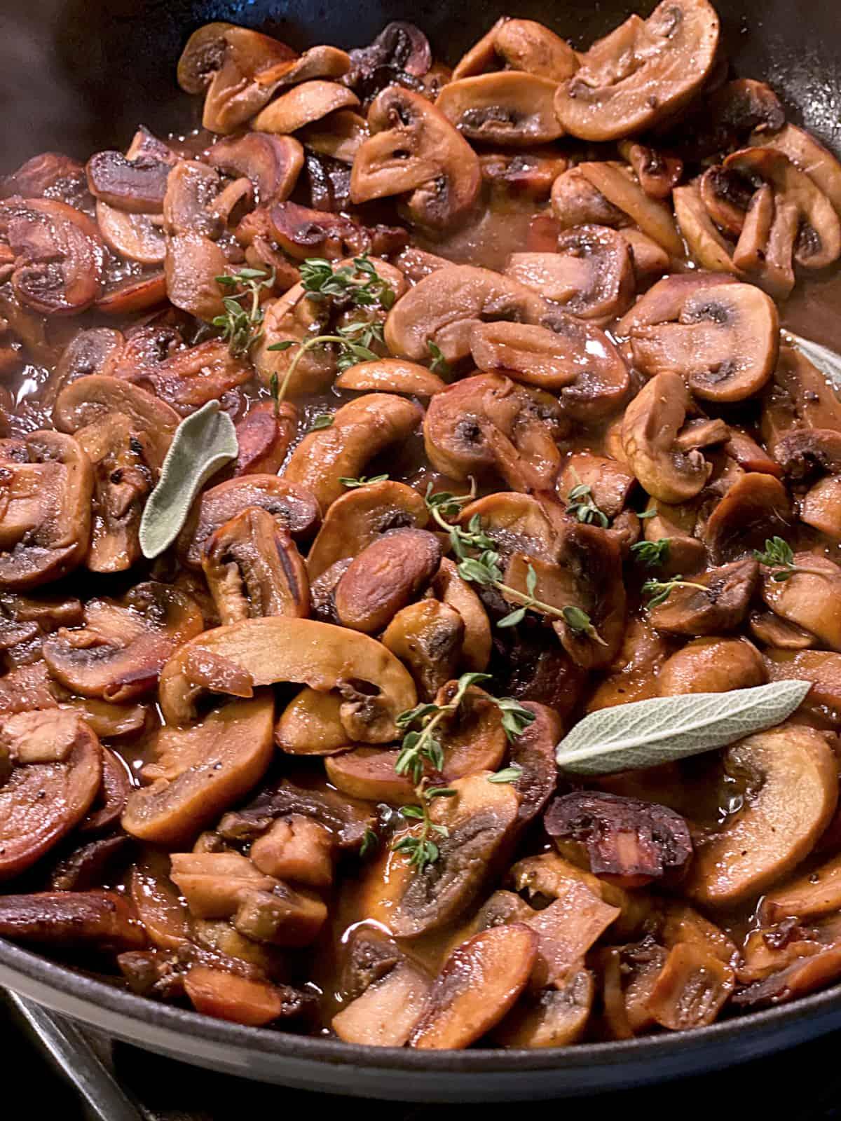 Sliced mushrooms in a skillet.
