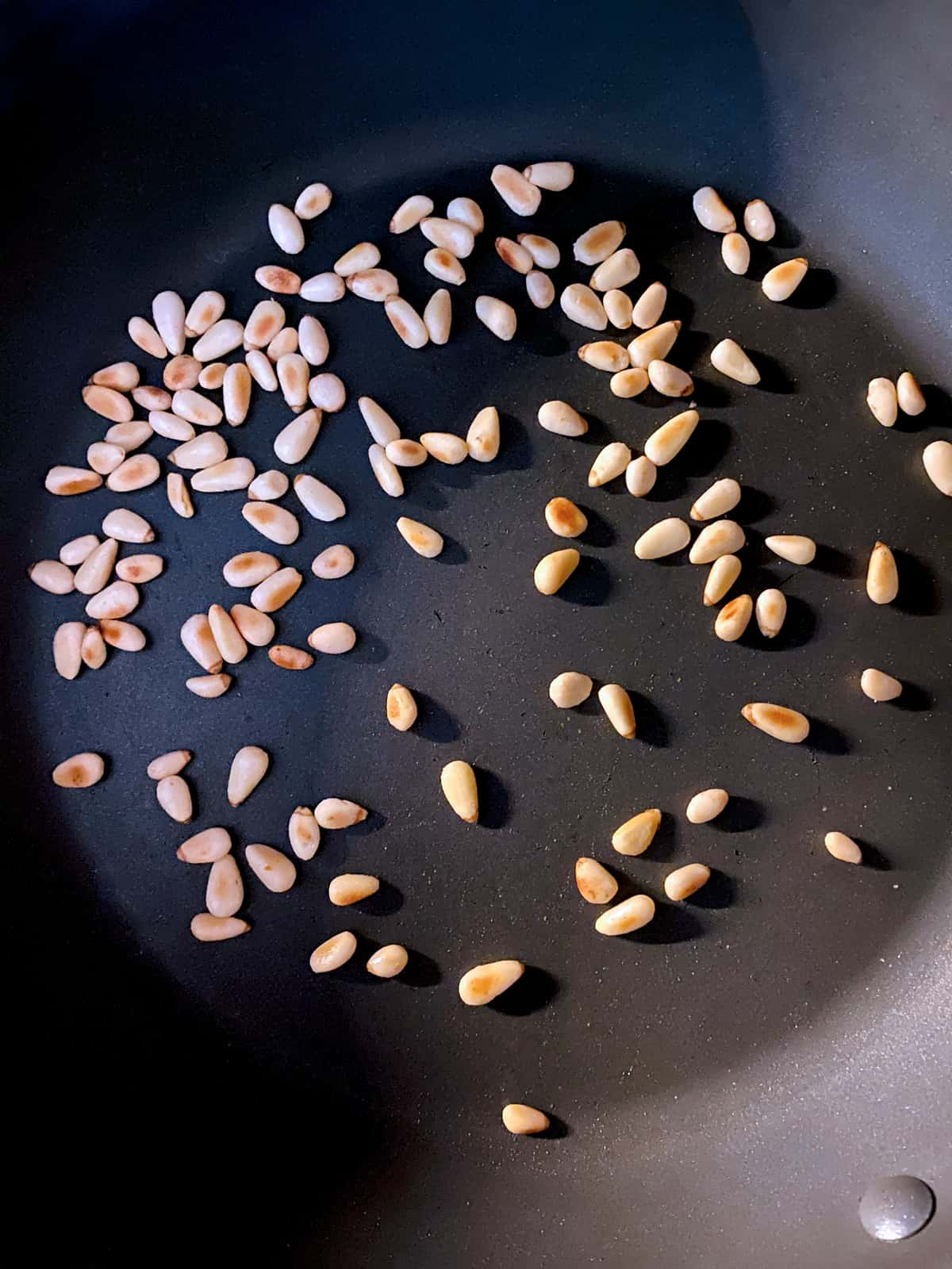 Pine nuts in a pan.