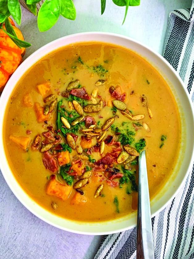 A bowl with sweet potato chowder soup.