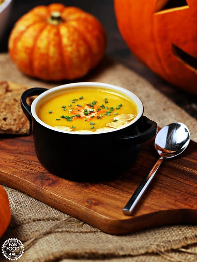 A bowl with curried pumpkin soupwith coconut milk.