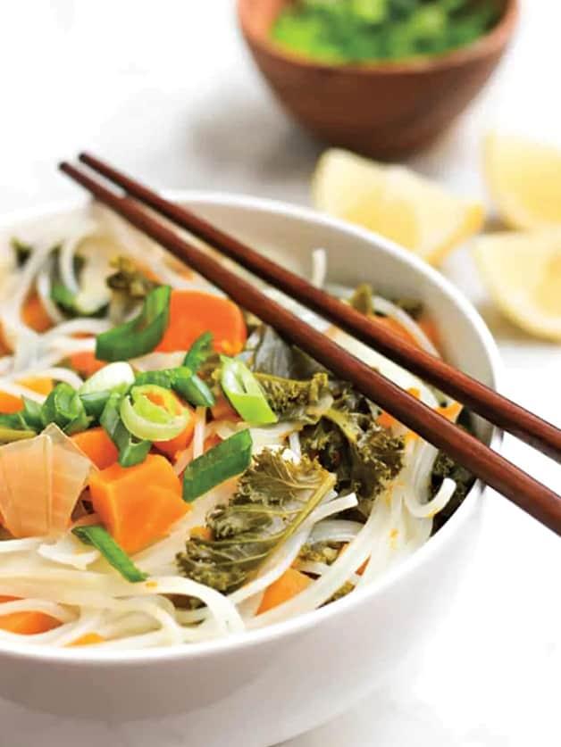 A bowl with vegetable noodle soup.