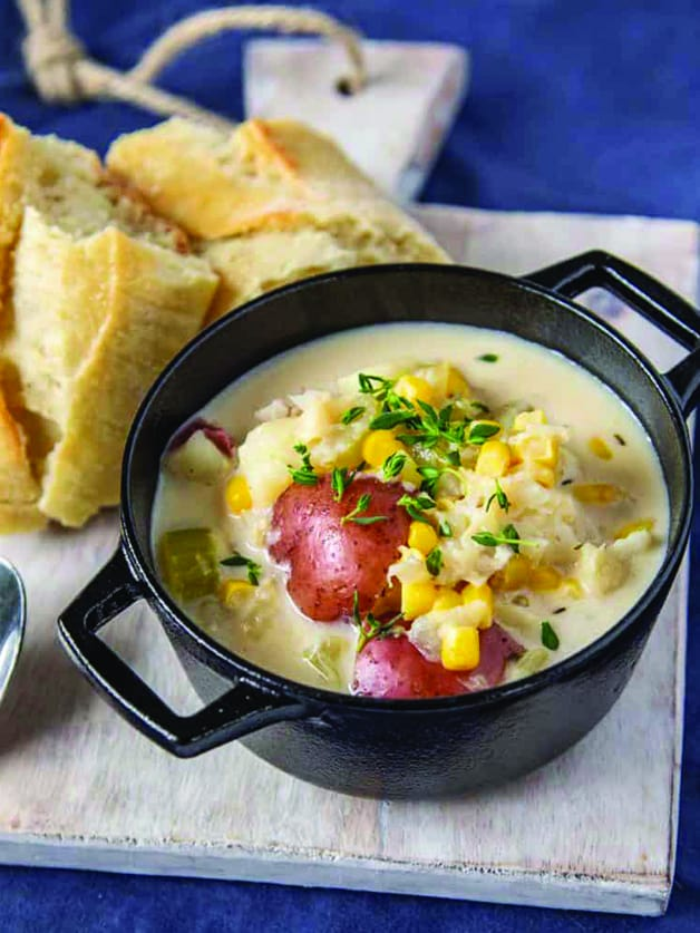 A bowl with fish chowder soup.