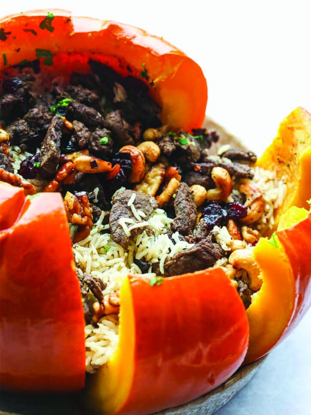 A stuffed pumpkin with rice ground beef and veggies.