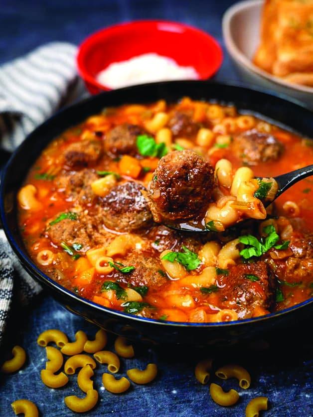A bowl with Italian meatball soup.