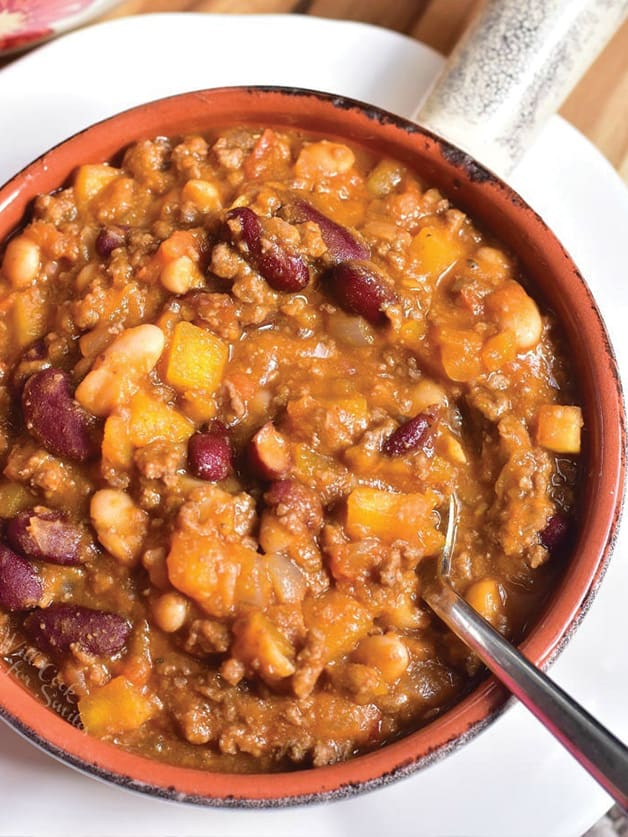 A bowl with pumpkin chili.